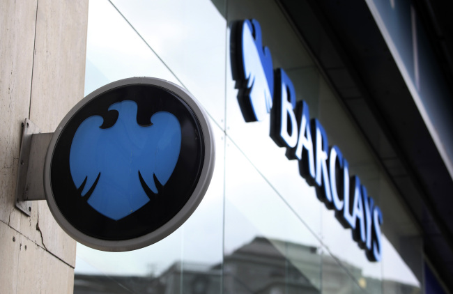 The Barclays Plc company logo hangs outside a bank branch in London. (Bloomberg)