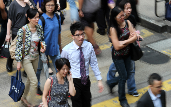 White-collar workers in Hong Kong may feel their options are cramped. Residents of large Asian cities spend more time at work than just about anyone else globally. (Parker Zheng/China Daily)