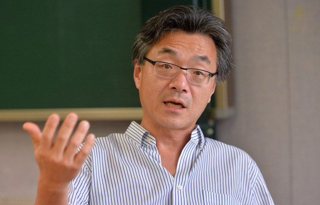 John Lie speaks during an interview with The Korea Herald at Kyung Hee University. (Lee Sang-sub/The Korea Herald)