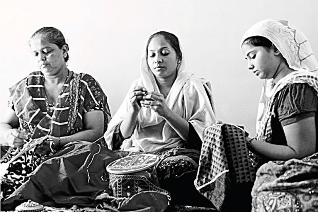 Women work at Colours Of India. (The Star)