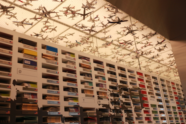 The map shelf, which resembles a mail sorting office, displays the maps of major tourist cities around the world. (Bae Hyun-jung/The Korea Herald)