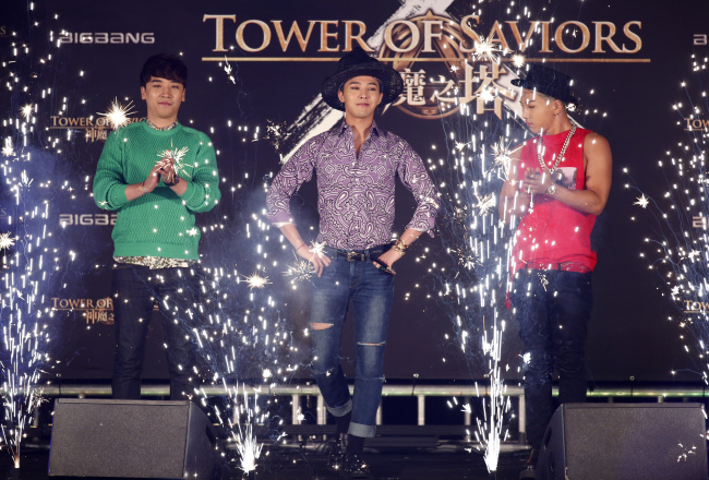 Korean K-pop group Big Bang members attend a promotional event for a mobile game in Hong Kong on July 29. (AP-Yonhap)