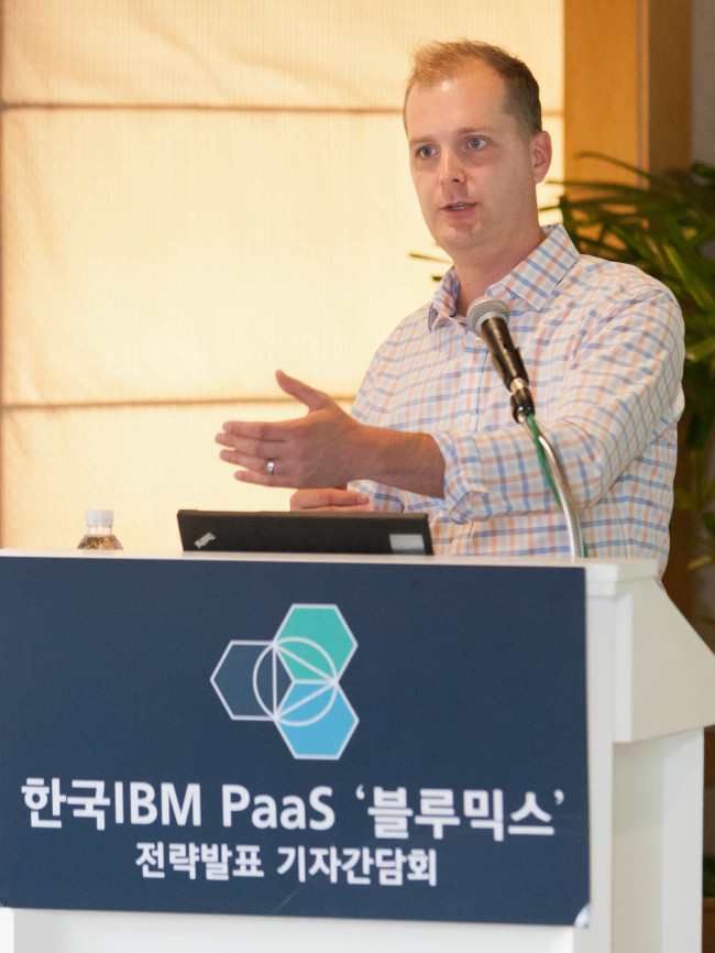 Adam Kocoloski, chief technology officer of Cloudant, an affiliate of IBM, speaks to the press about IBM's newly launched cloud computing platform called Bluemix in Seoul on Thursday. (IBM)
