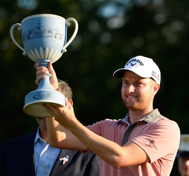 Chris Kirk poses with the winner's trophy on Monday. (EPA-Yonhap)