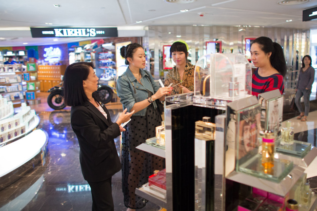 Customers sample perfumes inside the DFS Group Ltd. T Galleria store in the shopping district of Tsim Sha Tsui in Hong Kong. (Bloomberg)