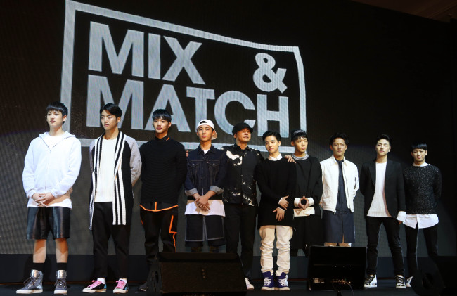 """YG Entertainment founder Yang Hyun-suk (center) poses along with the nine trainees who will participate in the upcoming boy band survival program """"Mix & Match"""" at a press conference in Seoul on Tuesday. (Yonhap)"""