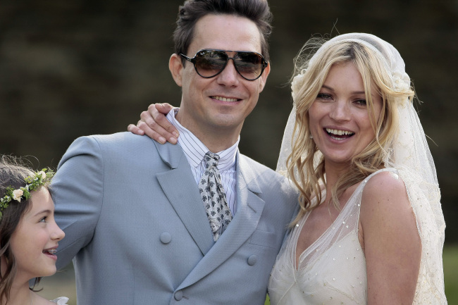 Kate Moss and her new husband Jamie Hince pose for photographs outside St. Peter's Church in Southrop, Gloucestershire, July 1, 2011. Moss, 37, and Hince, 42, a guitar player with The Kills, posed for photos outside the church in the village of Southrop in southern England after the ceremony. (Chicago/PA Photos/Abaca Press/MCT)