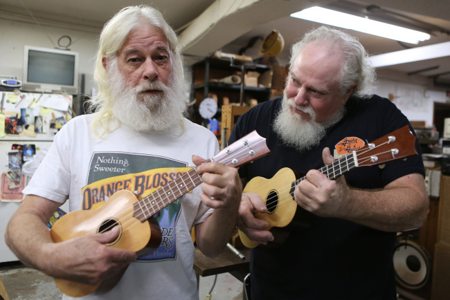 Owners Bill Fels (right) and Doug Montgomery build and repair guitars at the Guitar Factory in Orlando, Florida. (MCT)