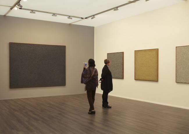 Visitors view Dansaekhwa paintings by artist Ha Chong-hyun at the Frieze Masters. (Frieze Art Fair)
