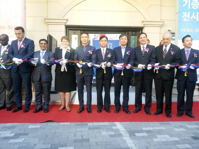 Foreign envoys take part in a ribbon-cutting ceremony during the opening reception of a special exhibition at the Multiculture Museum in Seoul on Tuesday. (Philip Iglauer/The Korea Herald)