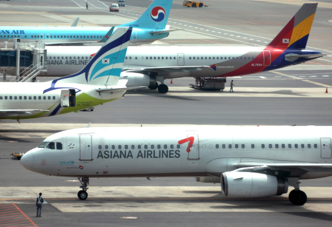Asiana Airlines passenger jets parked at Incheon International Airport. Bloomberg