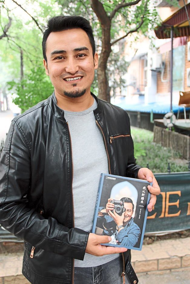 Kurbanjan aspires to repaint the image of Xinjiang and its people through his book. (The Star)