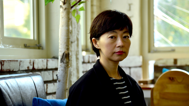 Film director Boo Ji-young poses before an interview with The Korea Herald in Samcheong-dong, Seoul, last week. (Yoon Byung-chan/The Korea Herald)