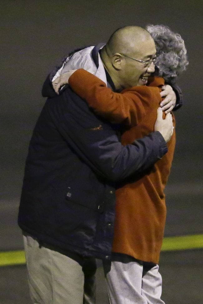 Kenneth Bae and his mother Bae Myung-hee embrace as they reunite on Saturday. (AP)