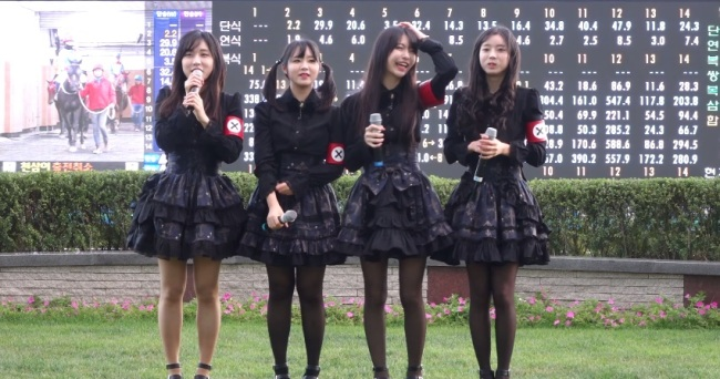 Rookie K-pop girl group Pritz was criticized for its outfits that bore similar features to Nazi uniforms. (YouTube screen capture)