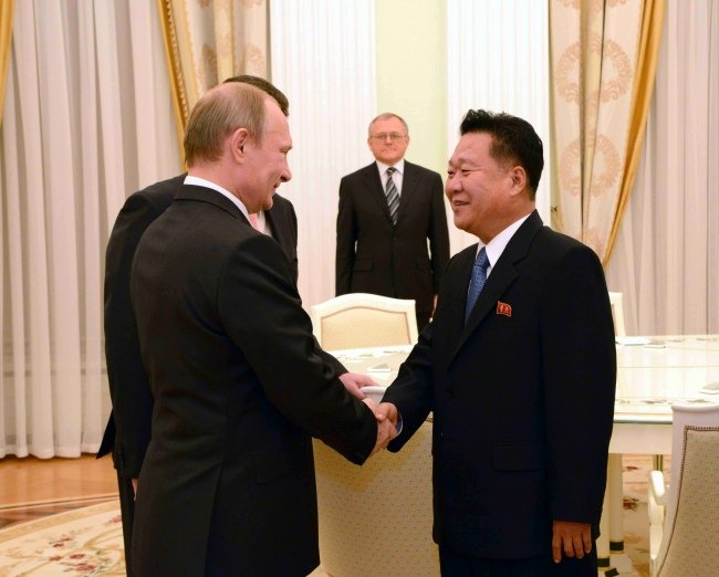 Choe Ryong-hae (right), a secretary of the North's ruling Workers Party, shakes hands with Russian President Vladimir Putin before their talks at the Kremlin Palace in Moscow, Russia, on Nov. 18. (Yonhap)