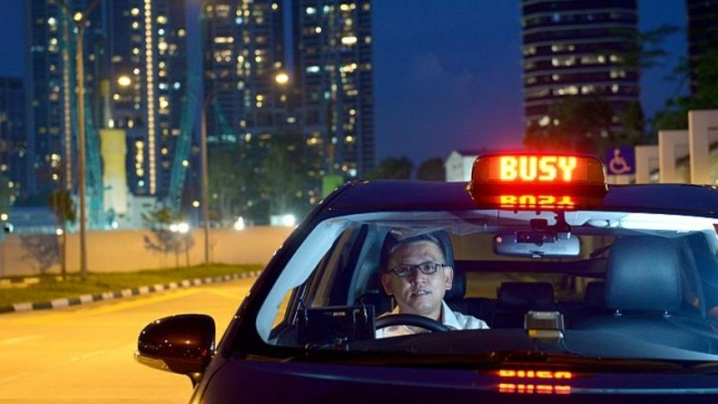 A taxi driver works a night shift in Singapore. (The Strait Times)
