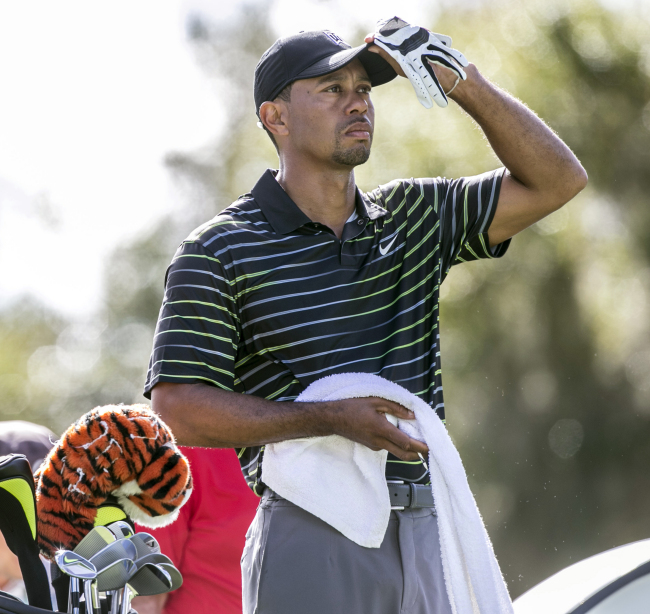 Tiger Woods checks out the course from the third tee on Thursday. (AP-Yonhap)