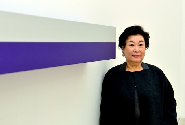 Lee Hyun-sook, founder and owner of Kukje Gallery in Seoul, poses for a photo with a Donald Judd sculpture at her gallery. (Yoon Byoung-chan/The Korea Herald)