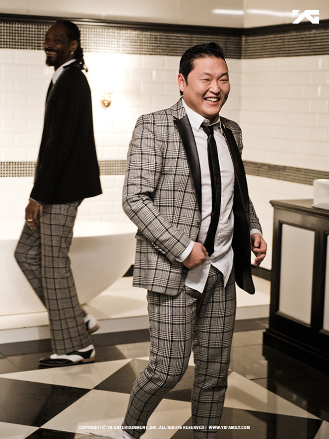 """Still capture of Psy's """"Hangover"""" music video, featuring American hip-hop star Snoop Dogg. (YG Entertainment)"""