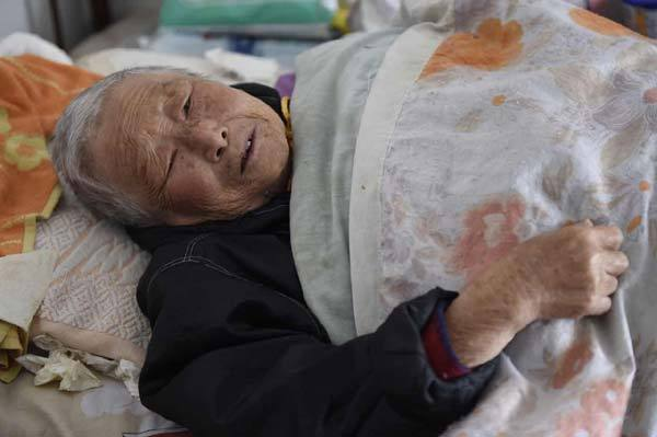 Ren Wenying, 91, a survivor of the Nanjing Massacre, tells what she went through 77 years ago two days before the first National Memorial Day for Nanjing Massacre Victims, which fell on Dec. 13. (China Daily)