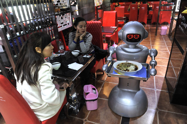 A robot waits on a table at a restaurant in Chengdu, Sichuan Province.