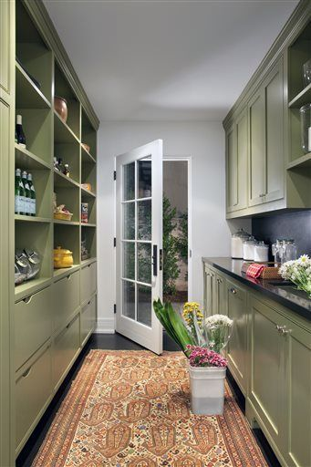 """A prep kitchen where the design firm used Sherwin Williams """"Olive Grove""""/SW7734 paint in a satin finish, in Beverly Hills, California. (AP-Yonhap)"""