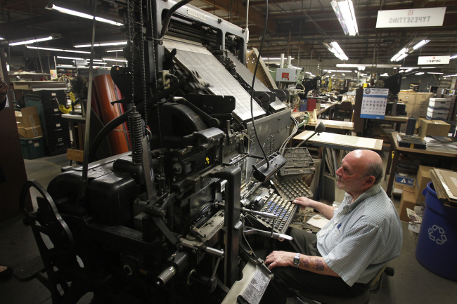 Owner Rick Kavin, who has worked for his father, Mel Kavin, since he was 14 years old, creates lead type on an oldIntertype machine at Kater-Crafts. (Allen J. Schaben/Los Angeles Times/TNS)