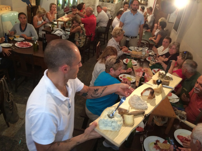 A long board with 10 types of cured meats elicits a collective gasp from diners at Eros Buratti's shop in Verbania, Italy. (TNS)