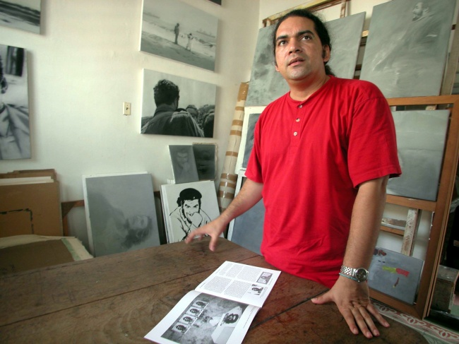Cuban artist Jose Angel Toirac poses in his studio in Havana, Cuba. He has done a series of irreverent paintings of Fidel Castro that have not been exhibited. (Tribune Content Agency)