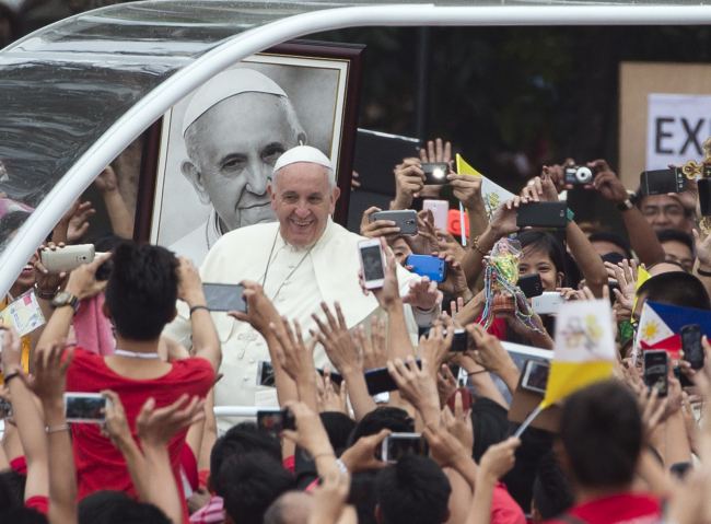 Pope Francis arrives to meet youths in Santo Tomas University in Manila, Philippines, Jan. 18. (AP)