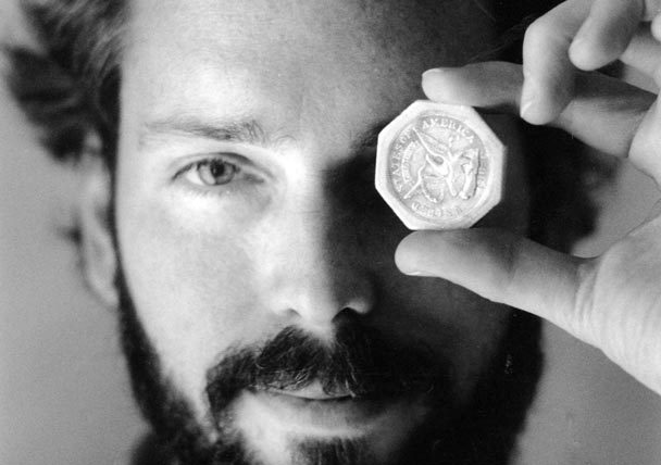 In this file photo taken in 1989, Tommy Thompson holds a $50 pioneer gold piece, retrieved that year from the wreck of the gold ship Central America. (AP-Yonhap)