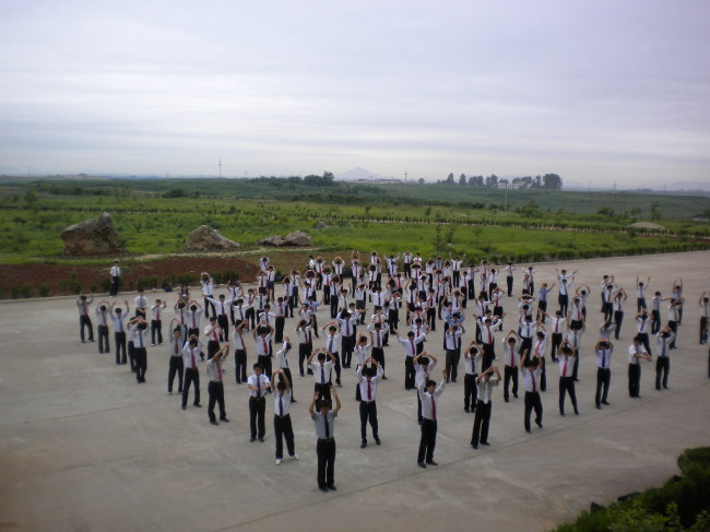 PUST students engage in group exercise outdoors.(Suki Kim)