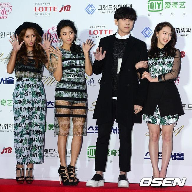 Sistar, minus Soyou, pose with hip-hop singer Junggigo (OSEN)