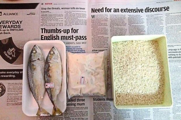 A photo submitted by Atty Sulaiman showing what a person can buy with RM7 a day ― (from left) fish, tempe and rice. (The Star)