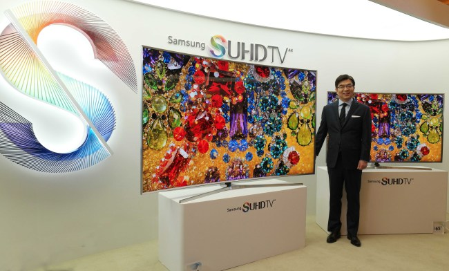 Kim Hyun-seok, head of Samsung Electronics' TV business unit, poses with the 2015 SUHD TV lineup at a press conference held in Seoul Thursday. Samsung Electronics