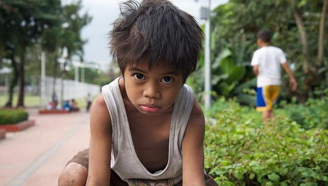 Deo says he is 6 years old, yet he looks much younger. Most street children in Manila suffer from malnutrition as their meals largely consist of instant noodles. (The Straits Times)