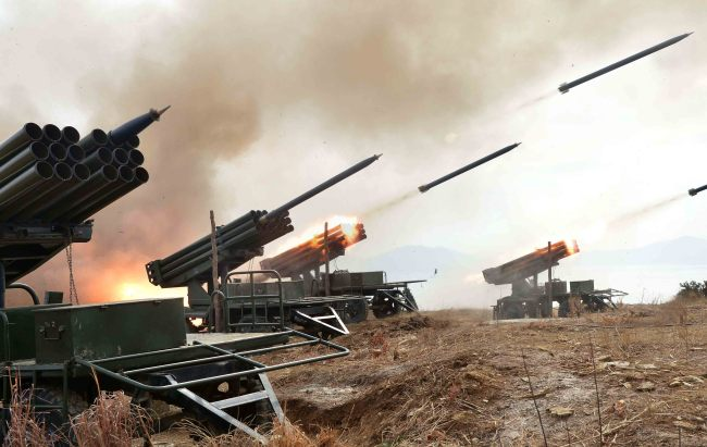 Rockets are fired during a North Korean live-ammunition exercise. The Rodong Sinmun reported Saturday that the troops under the 4th Corps of the North's Korean People's Army had carried out the drills. (Yonhap)