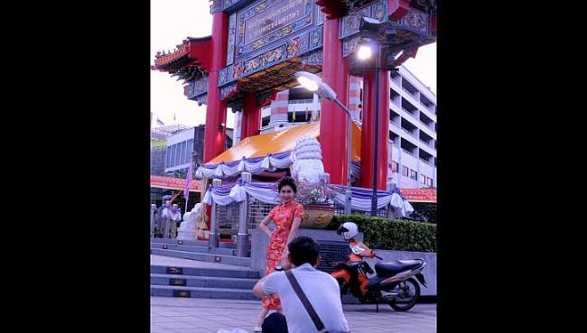 Photo shoots before Chinese New Year are common at the big gate that marks the entrance of the Yaowarat Road gold district in Bangkok. (The Straits Times)