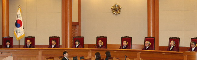 Nine judges deliver a decision at the Constitutional Court in Seoul on Thursday. (Yonhap)