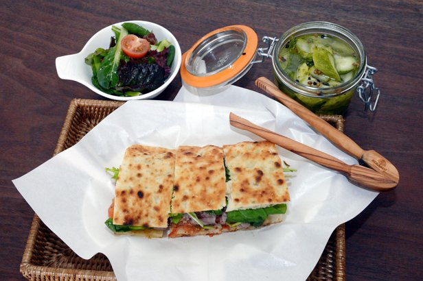Panisse's Paris Paris sandwich features herb-marinated medium-rare beef, fresh greens and onion confit and is served in warm flatbread. (Chung Hee-cho/The Korea Herald)