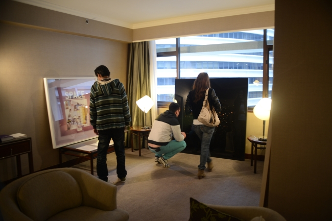 Visitors look at artworks on display during last year's Art Edition fair at Marco Polo Hong Kong Hotel & Harbour City in Hong Kong. (Art Edition)