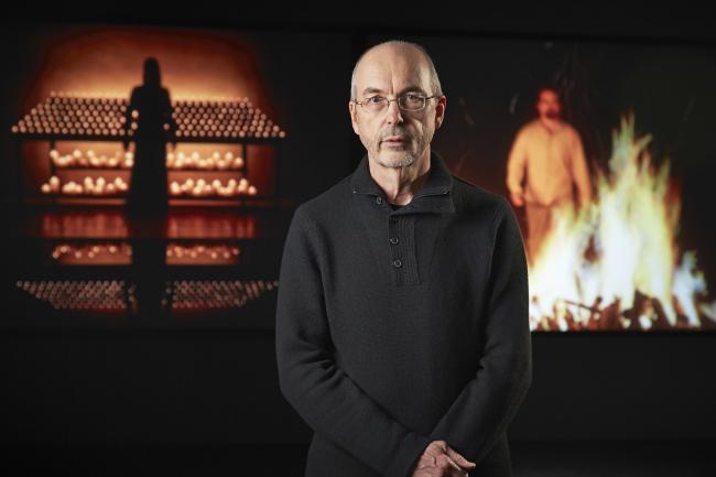 """Bill Viola poses in front of """"Night Vigil"""" at Kukje Gallery. (Kukje Gallery)"""