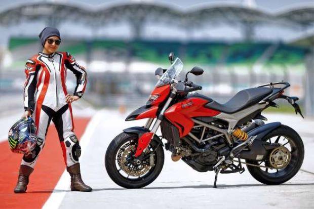 Nurulalis Aidil Akhbar poses with her bike. (The Star)