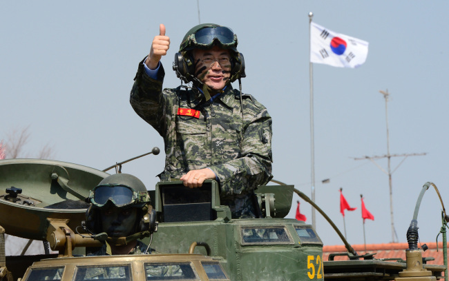 New Politics Alliance for Democracy leader Rep. Moon Jae-in takes a ride on an amphibious armored vehicle during his visit to the 2nd Marine Division at Gimpo, Gyeonggi Province, Wednesday. (Yonhap)