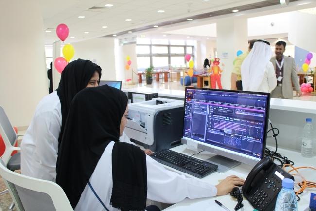 Saudi hospital employees look at a medical information system built by SK Telecom and Seoul National University Hospital Bundang, at King Abdullah Specialist Children Hospital in Riyadh, Saudi Arabia, on April 19. (Seoul National University Hospital Bundang)