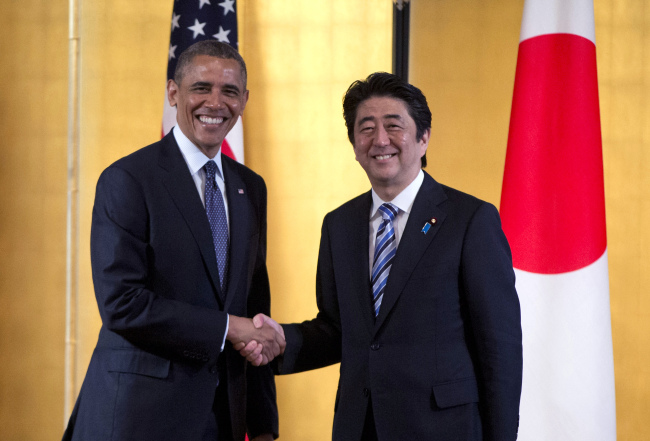 President Barack Obama shakes hands with Japanese Prime Minister Shinzo Abe as they arrive to participate in a bilateral meeting at the Akasaka State Guest House in Tokyo last April. (AP-Yonhap)