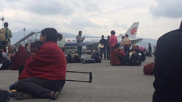 Dhany Osman, a sub-editor with The Straits Times, was in Nepal with his girlfriend. They were waiting for their flight to Kuala Lumpur when the quake struck on Saturday, April 25, 2015. Passengers shoved and rushed out of the terminal at Tribhuvan International Airport. (Dhany Osman/The Straits Times)