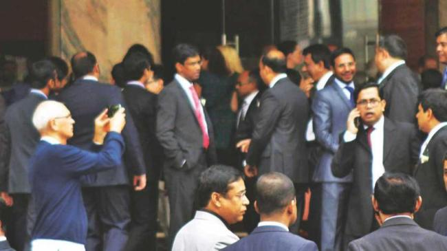 Panicked people get out of The Westin Hotel in Gulshan-2 on Saturday following the earthquake. (The Daily Star)