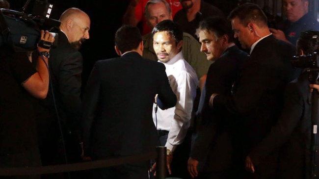 Manny Pacquiao leaves after a press conference following his defeat to Floyd Mayweather. (Philippine Daily Inquirer)